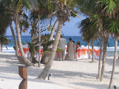 A white sand beach wedding with sunset  orange accents by PJ!
